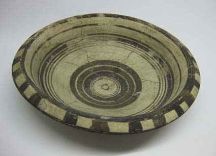 Bichrome dish repaired by A.M. Woodward © University of Leeds