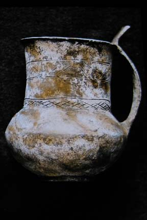 Tankard with thumb grip and incised decoration. © Leeds Museums and Galleries